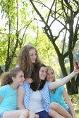 Teenage girls posing for a self-portrait — Stock Photo