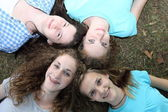 Four smiling attractive teenage girls — Стоковое фото
