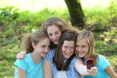 Laughing group of friends taking their photo — Stock Photo