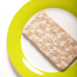 Single wheat cracker on a plate — Stock Photo