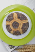Gourmet poppy seed roll on a plate — Stock Photo