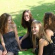 Smiling young teenagers relaxing in the park — Stock Photo