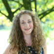Smiling teenager with beautyful curly hair — Stock Photo