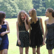 Teenage girls walking through the park — Stock Photo