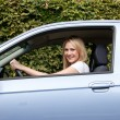 Smiling woman driving her car — Stock Photo