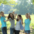 Group of young teenage friends cheering — Stockfoto