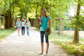 Attractive young teenage girl on her way to class — Stock Photo