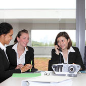 Three successful businesswomen in a meeting — Stock Photo