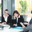 Group of young business professionals in a meeting — Stock Photo