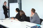 Businessswoman giving a presentation — Stock Photo