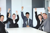 Jubilant successful business team — Stock Photo