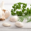 Fresh garlic cloves and herbs — Stock Photo