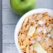Breakfast cereal with diced and fresh apple — Stock Photo