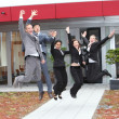 Triumphant business team cheering and celebrating — Stockfoto