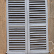 Window with closed wooden shutters — Stock Photo