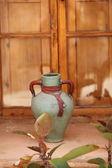 Decorative vase against wood background — Stock fotografie