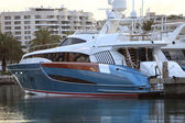 Luxury motorboat moored near an apartment block — Stock Photo
