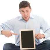 Worried man pointing to his tablet computer — Stock Photo