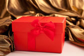 Red gift box with luxury gold fabric — Stock Photo