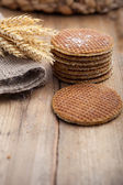 Round waffle cakes with ears of wheat — Stock Photo
