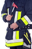 Fireman in uniform with a fire axe — Stockfoto