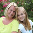Stock Photo: Friendly blond teenager with her mother