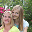 Affectionate teenage girl posing with her mother — Stock Photo #40271509