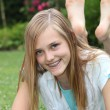 Happy barefoot carefree teenage girl — Stockfoto
