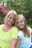 Friendly blond teenager with her mother — Stock Photo