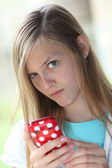 Wary teenage girl protecting her privacy — Stock Photo