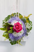 Unusual floral posy incorporating a blue textile — Stock Photo