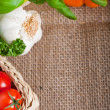 Stock Photo: Fresh cooking ingredients on hessian