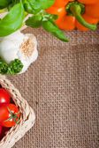 Fresh cooking ingredients on hessian — Stock Photo