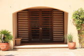Closed double slatted door under a recess — Stock Photo