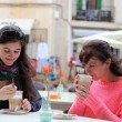Stock Photo: Two women friends having coffee together