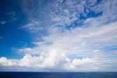 Beautiful cloudscape over a blue ocean — Stock Photo