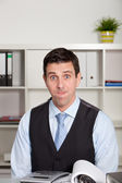 Frustrated businessman pulling a face — Stock Photo