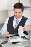 Businessman smiling in satisfaction — Stock Photo