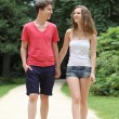 Stock Photo: Attractive young teenage couple out walking