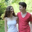 Attractive teenage couple out walking — Stock Photo