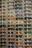 Display of modern sunglasses in a store — Stock Photo