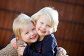 Happy twin sisters smiling — Stock Photo