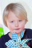 Beautiful little girl with a blue toy pinwheel — Stock Photo