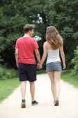 Young dating teenage couple taking a walk — Stock Photo