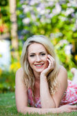 Beautiful woman with a happy smile in the garden — Stock Photo