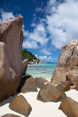 Rocky tropical beach on a hot summer day — Stock Photo