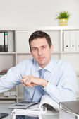 Businessman with a serious speculative look — Stock Photo