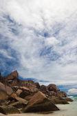 Rocky outcrop on a tropical beach — Stock Photo