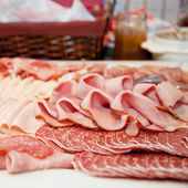 Cold meat platter on a buffet table — Stock Photo