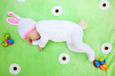 Cute sleeping baby in an Easter Bunny suit — Stock Photo